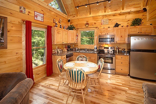 kitchen and dining area at at brownie bear a 1 bedroom cabin rental located in gatlinburg