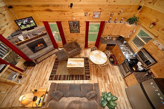 Looking down into living room from the lofted game room at Brownie Bear, a 1-bedroom cabin rental located in Gatlinburg