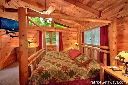 Log framed canopy bed in bedroom at Black Bear Magic, a 4-bedroom cabin rental located in Gatlinburg