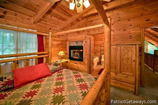 Bedroom with ensuite and fireplace at Black Bear Magic, a 4-bedroom cabin rental located in Gatlinburg