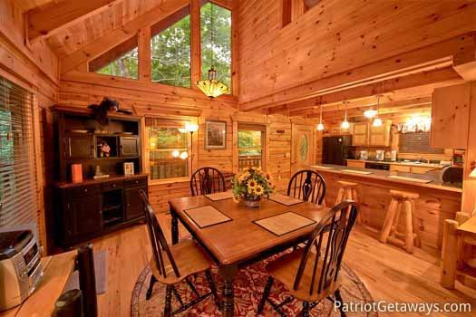 Dining area with seats for four at Black Bear Magic, a 4-bedroom cabin rental located in Gatlinburg