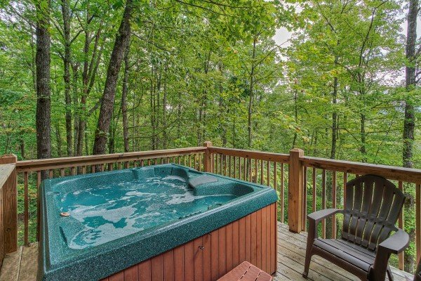 Hot tub with wooded view at Black Bear Magic, a 4-bedroom cabin rental located in Gatlinburg