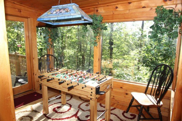 Foosball table at Black Bear Magic, a 4-bedroom cabin rental located in Gatlinburg