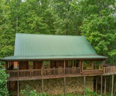 Exterior view of the cabin in the woods at Black Bear Magic, a 4-bedroom cabin rental located in Gatlinburg