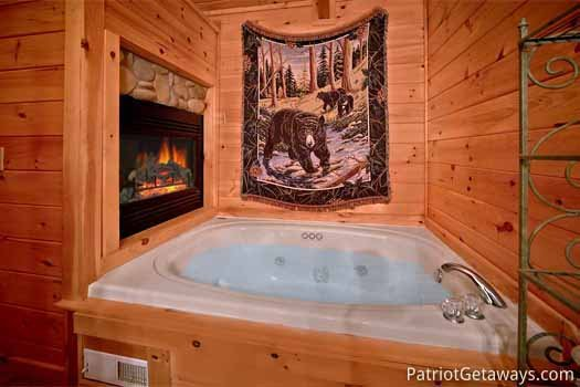 Jacuzzi tub with fireplace at Black Bear Magic, a 4-bedroom cabin rental located in Gatlinburg