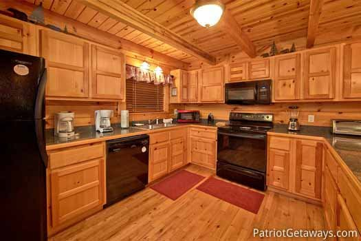 Black appliances in kitchen at Black Bear Magic, a 4-bedroom cabin rental located in Gatlinburg