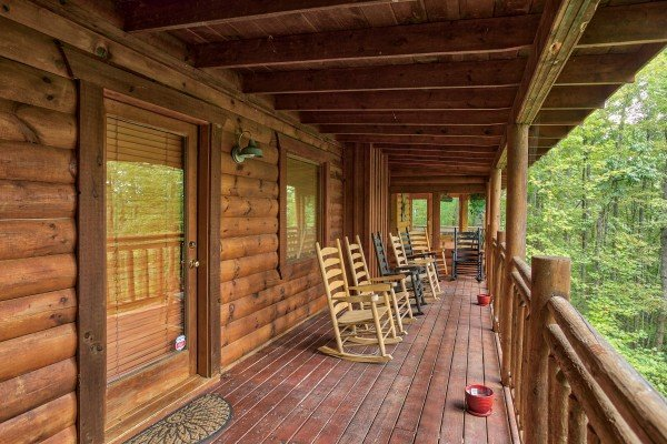 Covered porch with rocking chairs at Black Bear Magic, a 4-bedroom cabin rental located in Gatlinburg