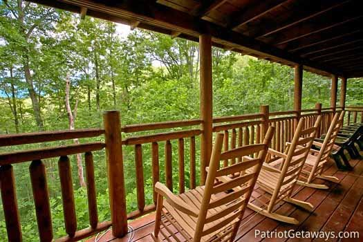 Rocking chairs under a covered deck at Black Bear Magic, a 4-bedroom cabin rental located in Gatlinburg