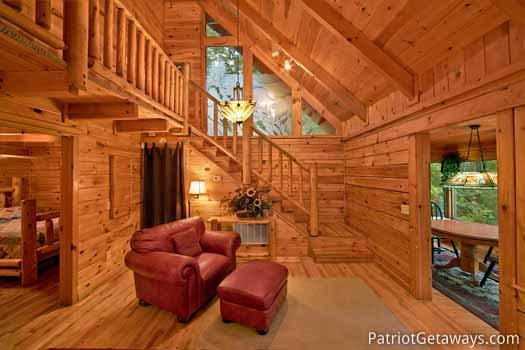 Living room staircase at Black Bear Magic, a 4-bedroom cabin rental located in Gatlinburg