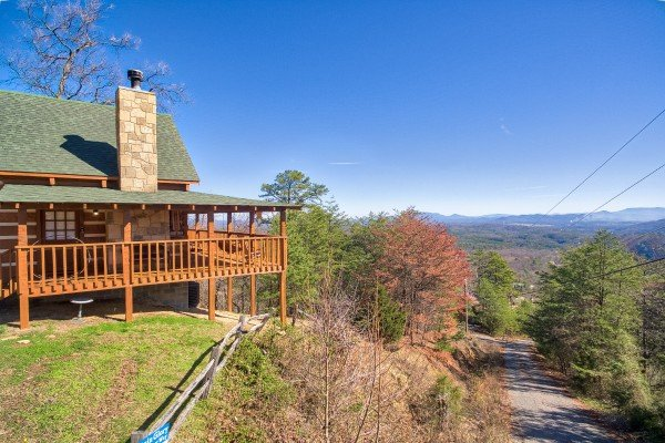 Cabin on the hillside overlooking the driveway at Mountain Glory, a 1 bedroom cabin rental located in Pigeon Forge