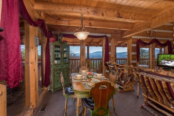 Dining space for four at Mountain Glory, a 1 bedroom cabin rental located in Pigeon Forge