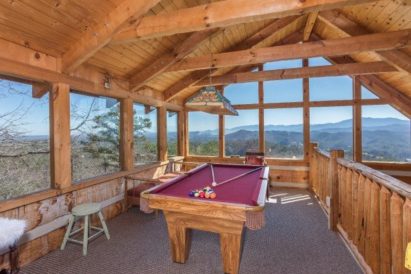 Pool table in the game loft overlooking the mountains at Mountain Glory, a 1 bedroom cabin rental located in Pigeon Forge