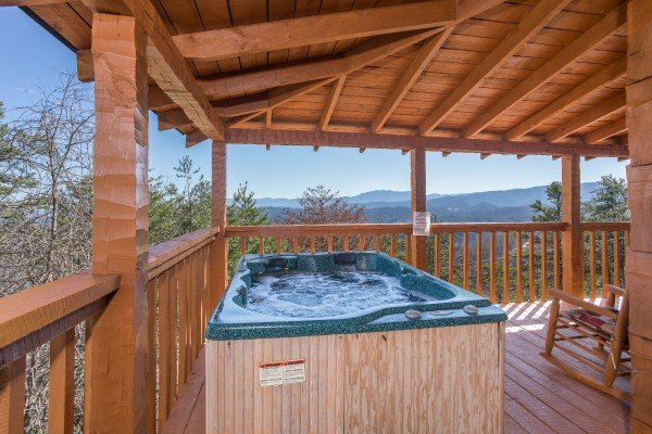 Hot tub on the covered deck overlooking the mountains at Mountain Glory, a 1 bedroom cabin rental located in Pigeon Forge