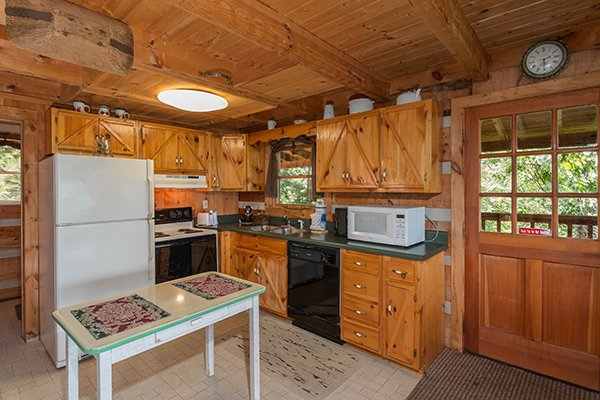 Kitchen with black and white appliances at Mountain Glory, a 1 bedroom cabin rental located in Pigeon Forge