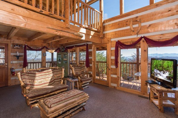 Living room with large windows with natural light at Mountain Glory, a 1 bedroom cabin rental located in Pigeon Forge