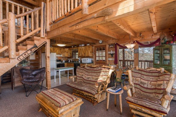 Open concept main floor with living room, dining space, and kitchen at Mountain Glory, a 1 bedroom cabin rental located in Pigeon Forge