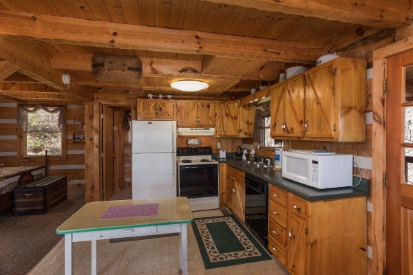 Studio style main floor with bedroom just off the kitchen at Mountain Glory, a 1 bedroom cabin rental located in Pigeon Forge