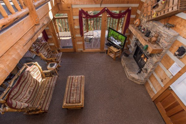 Looking down into the living room at Mountain Glory, a 1 bedroom cabin rental located in Pigeon Forge