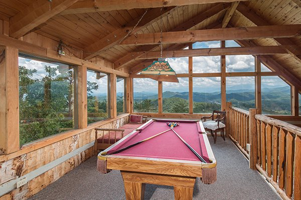 Pool table in the game loft at Mountain Glory, a 1 bedroom cabin rental located in Pigeon Forge