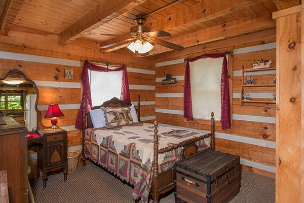 Bedroom on the main floor, studio style, at Mountain Glory, a 1 bedroom cabin rental located in Pigeon Forge