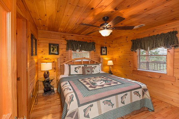 bedroom with queen bed and end tables at 1 amazing view a 2 bedroom cabin rental located in pigeon forge