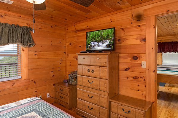 storage and television in bedroom at 1 amazing view a 2 bedroom cabin rental located in pigeon forge