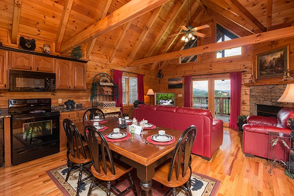 dining room seating for six and kitchen at 1 amazing view a 2 bedroom cabin rental located in pigeon forge