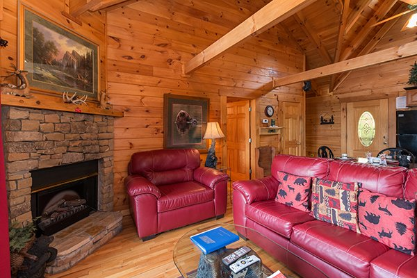 fireplace and living room at 1 amazing view a 2 bedroom cabin rental located in pigeon forge