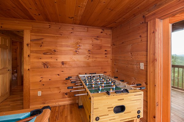 foosball table in game room at 1 amazing view a 2 bedroom cabin rental located in pigeon forge