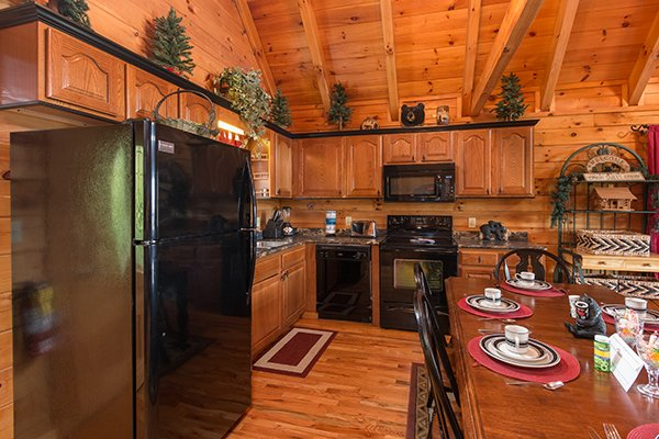 kitchen with black appliances at 1 amazing view a 2 bedroom cabin rental located in pigeon forge