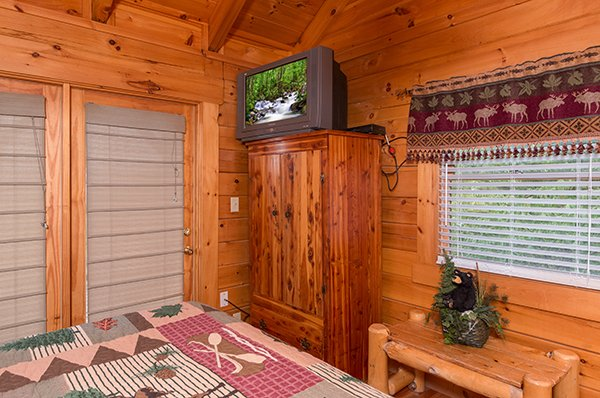 storage space and tv in master bedroom at 1 amazing view a 2 bedroom cabin rental located in pigeon forge