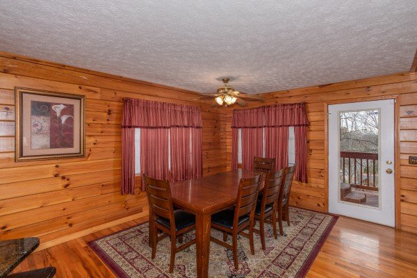 Dining space with seating for eight at Burrow Inn, a 4-bedroom cabin rental located in Pigeon Forge