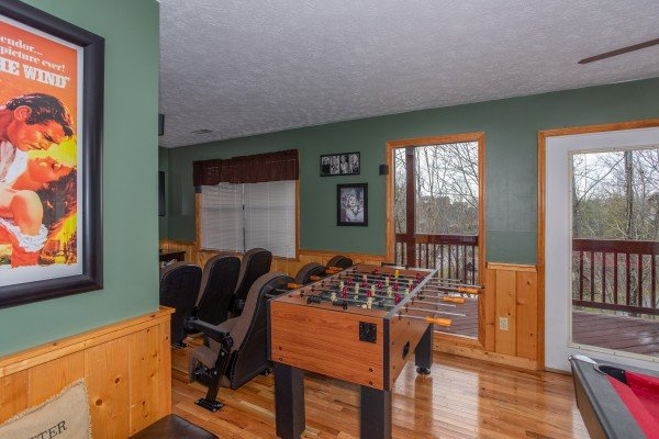 Foosball table next to the theater room at Burrow Inn, a 4-bedroom cabin rental located in Pigeon Forge