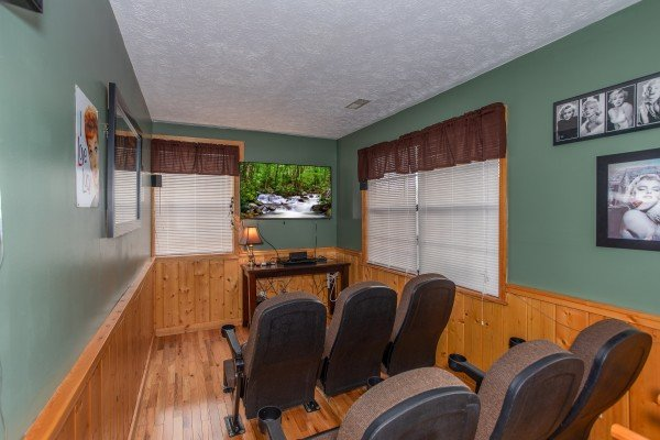 Theater seating for six at Burrow Inn, a 4-bedroom cabin rental located in Pigeon Forge