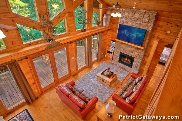 Looking down into the living room from the upper floor at Pot O' Gold, a 4 bedroom cabin rental located in Pigeon Forge