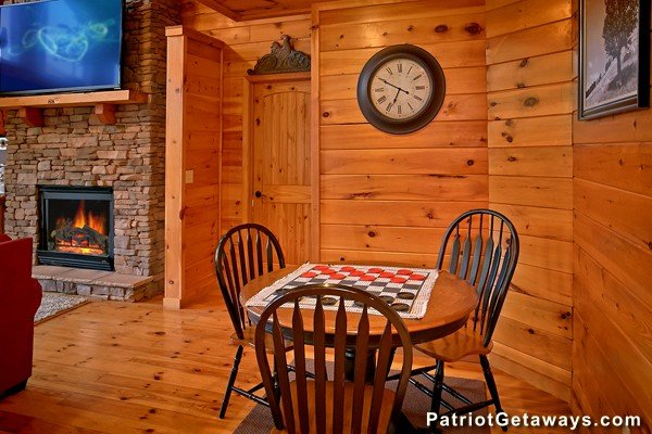 Table with checker game and chairs for three at Pot O' Gold, a 4 bedroom cabin rental located in Pigeon Forge