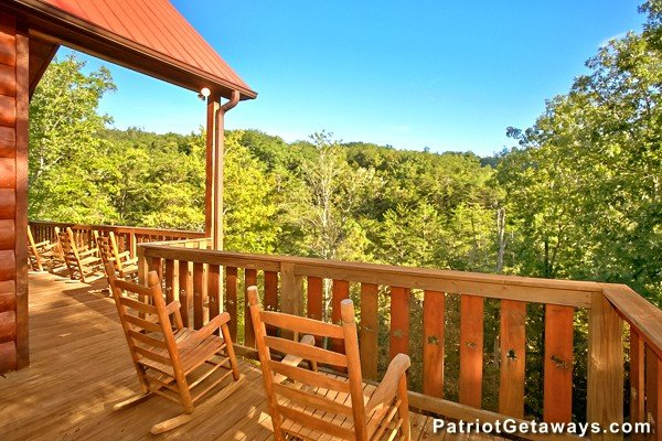 Wooded treetop views from the deck at Pot O' Gold, a 4 bedroom cabin rental located in Pigeon Forge