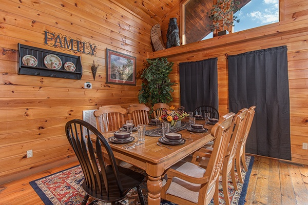 Dining table for 8 at Pot O' Gold, a 4 bedroom cabin rental located in Pigeon Forge