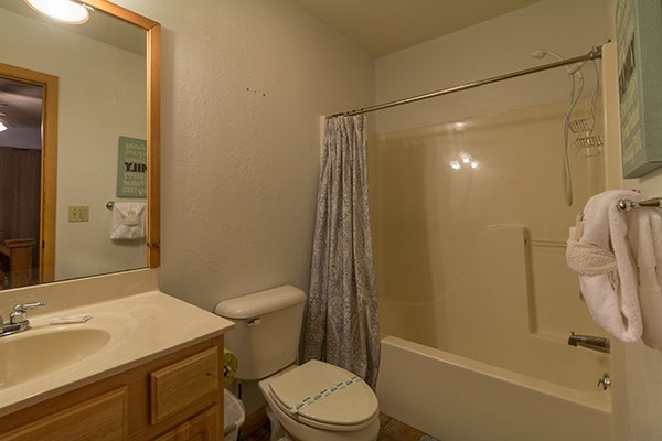 Bathroom with a tub and shower at Pot O' Gold, a 4 bedroom cabin rental located in Pigeon Forge