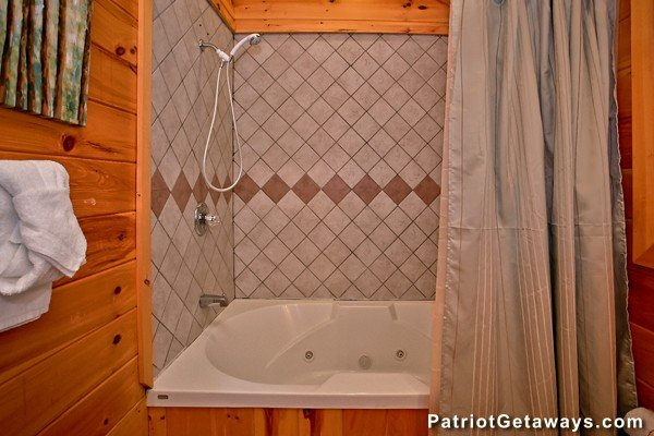 Jacuzzi shower combo in the downstairs bathroom at Pot O' Gold, a 4 bedroom cabin rental located in Pigeon Forge