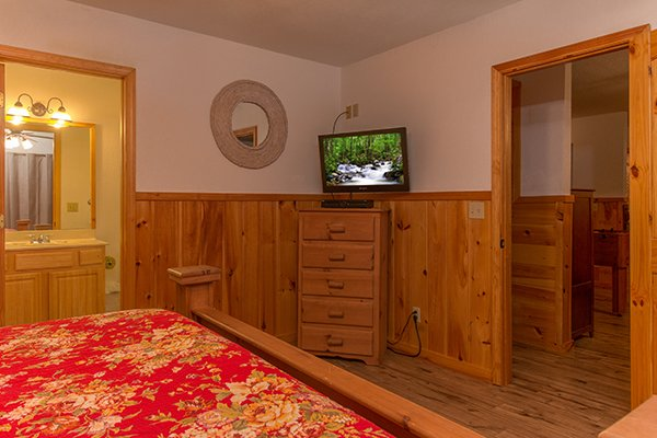 Chest of drawers and TV in the bedroom at Pot O' Gold, a 4 bedroom cabin rental located in Pigeon Forge