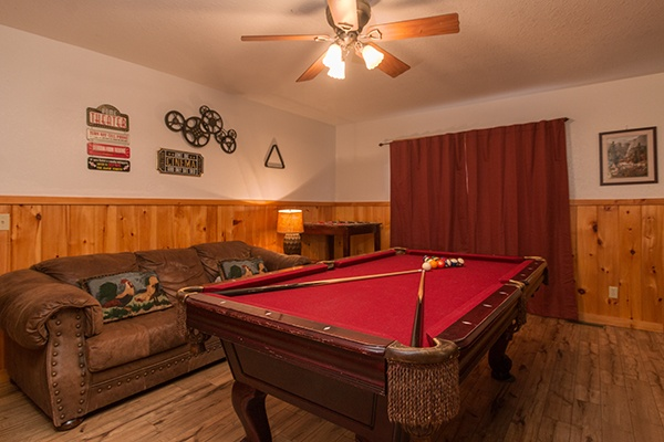 Red felt pool table at Pot O' Gold, a 4 bedroom cabin rental located in Pigeon Forge