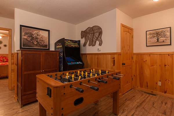 Game room with foosball and arcade game at Pot O' Gold, a 4 bedroom cabin rental located in Pigeon Forge