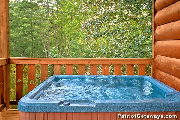 Hot tub on the deck at Pot O' Gold, a 4 bedroom cabin rental located in Pigeon Forge