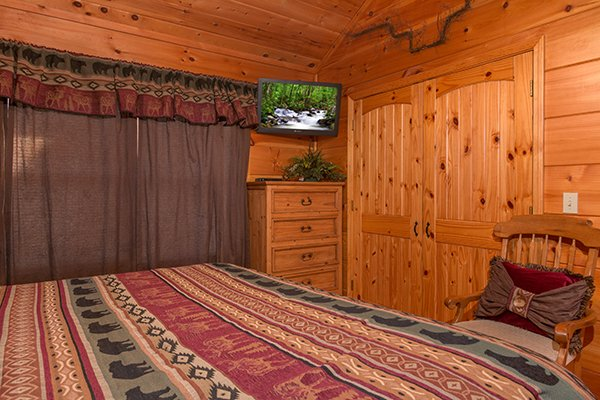 Chest of drawers with TV in the main floor bedroom at Pot O' Gold, a 4 bedroom cabin rental located in Pigeon Forge