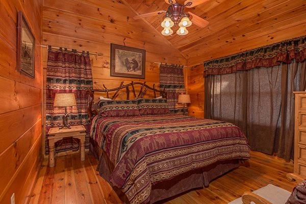 King bedroom at Pot O' Gold, a 4 bedroom cabin rental located in Pigeon Forge