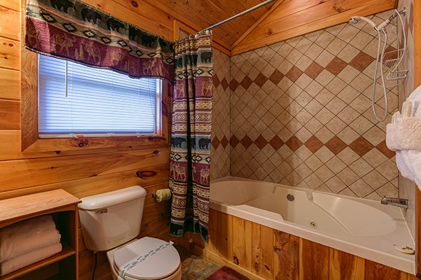 Jacuzzi and shower combo at Pot O' Gold, a 4 bedroom cabin rental located in Pigeon Forge