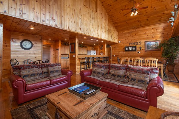 Living room with two dining spaces and kitchen on the main floor at Pot O' Gold, a 4 bedroom cabin rental located in Pigeon Forge