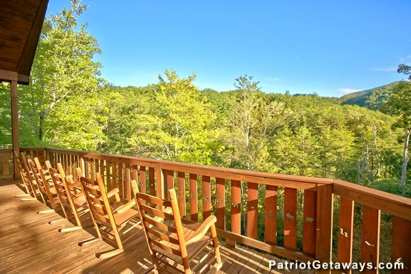 Rocking chairs overlooking the mountains and trees at Pot O' Gold, a 4 bedroom cabin rental located in Pigeon Forge