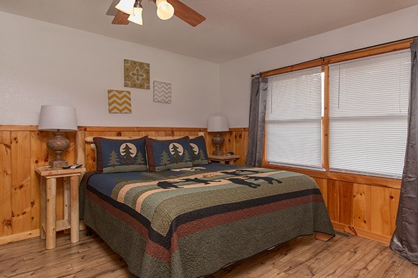King bedroom in a downstairs bedroom at Pot O' Gold, a 4 bedroom cabin rental located in Pigeon Forge